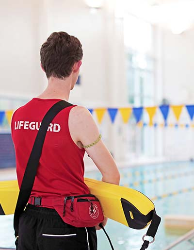 Lifeguard in training for swim lessons at the YMCA