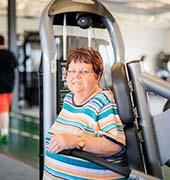Older woman using Gravity TRX machine