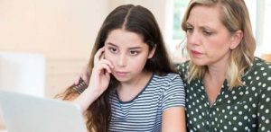 Mom and daughter discussing cyber bullying