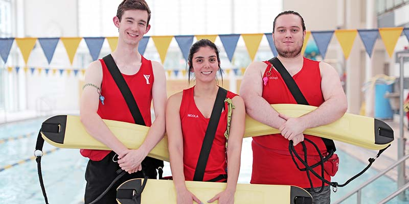 Three lifeguards at YMCA pool