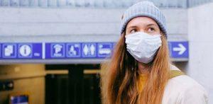 Teenage girl wearing a mask