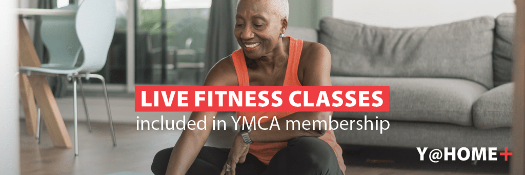Older woman watching live fitness class with Y@HOME+