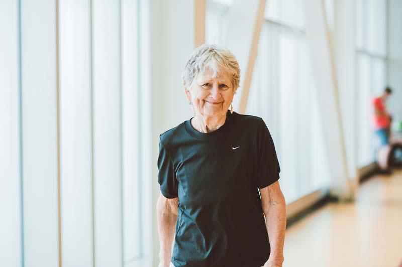 Elderly woman using walking track at YMCA