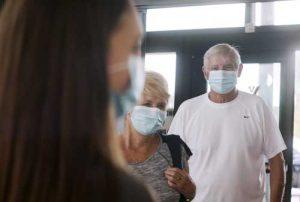 People wearing masks entering YMCA